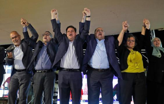 Leaders in the Arab Joint List celebrating securing at least a dozen seats in the elections (AHMAD GHARABLI/AFP/Getty Images)
