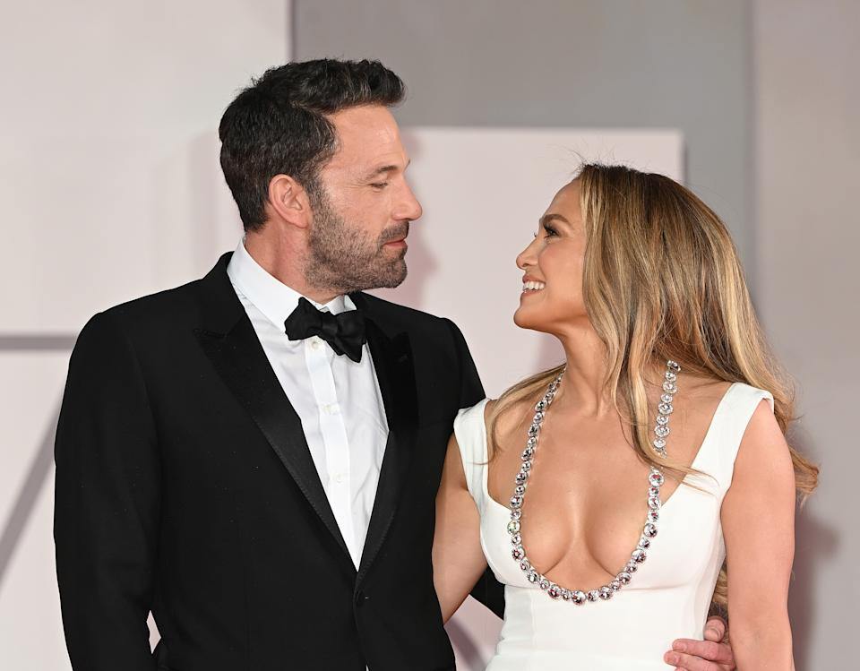 Ben Affleck looks lovingly at Jennifer Lopez during their red carpet debut (again) at the Venice Film Festival. (Photo: WireImage)
