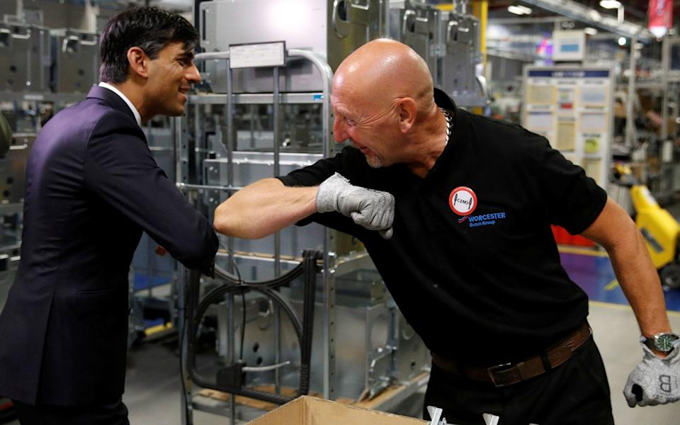 Rishi Sunak greets an employee during a visit to the Worcester Bosch factory - Phil Noble/PA