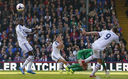 Chelsea's Demba Ba (L), Eden Hazard (C), and Fernando Torres react after Crystal Palace's goalie Julian Speroni saved a shot from Hazard and Torres failed to strike the rebound during their English Premier League soccer match at Selhurst Park in London March 29, 2014. REUTERS/Andrew Winning