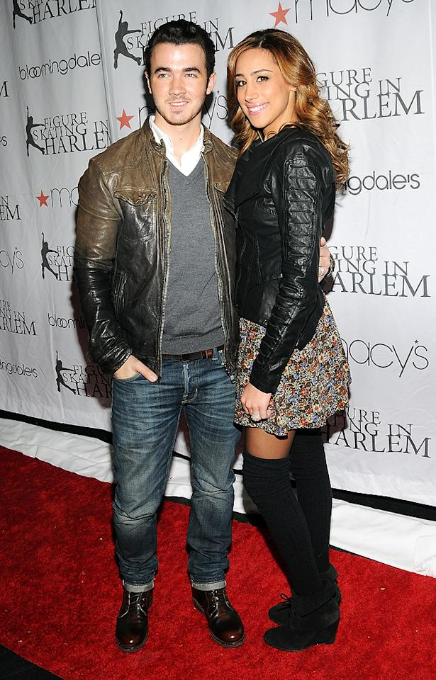 "<p class=""MsoNormal"">Kevin Jonas and his wife Danielle hit the red carpet at the Skating With the Stars event, held at NYC's Wollman Rink in Central  Park. The soiree was to benefit Skating in Harlem, a not-for-profit organization that provides girls ages 6-18 with vital educational and skating opportunities that build self-worth and promote physical well being and academic achievement. (4/2/2012)</p>"