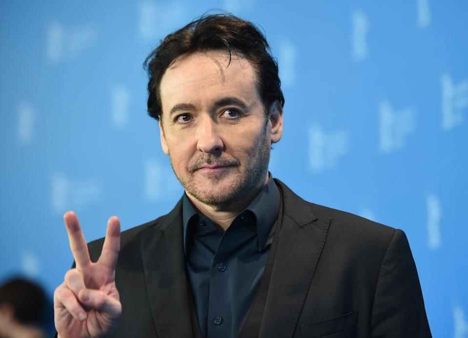 Actor John Cusack says Chicago police officers 'came at hime with batons' during the protests in Chicago on Saturday evening. (Photo: Britta Pedersen/picture alliance via Getty Images)