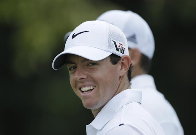 Rory McIlroy, of Northern Ireland, smiles as he walks down the 15th fairway during a practice round for the PGA Championship golf tournament at Oak Hill Country Club, Wednesday, Aug. 7, 2013, in Pittsford, N.Y. (AP Photo/Julio Cortez)