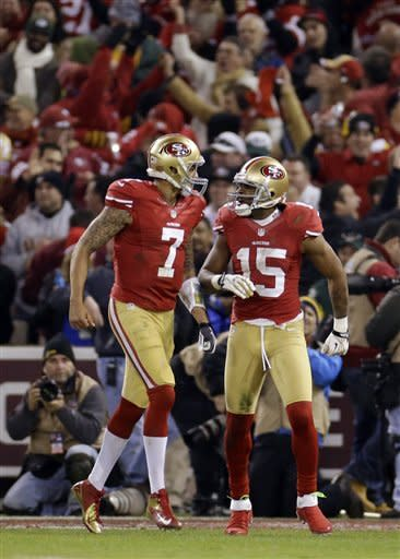 San Francisco 49ers wide receiver Michael Crabtree (15) and quarterback Colin Kaepernick (7) celebrate after connecting on a 12-yard touchdown reception during the second quarter of an NFC divisional playoff NFL football game against the Green Bay Packers in San Francisco, Saturday, Jan. 12, 2013. (AP Photo/Ben Margot)