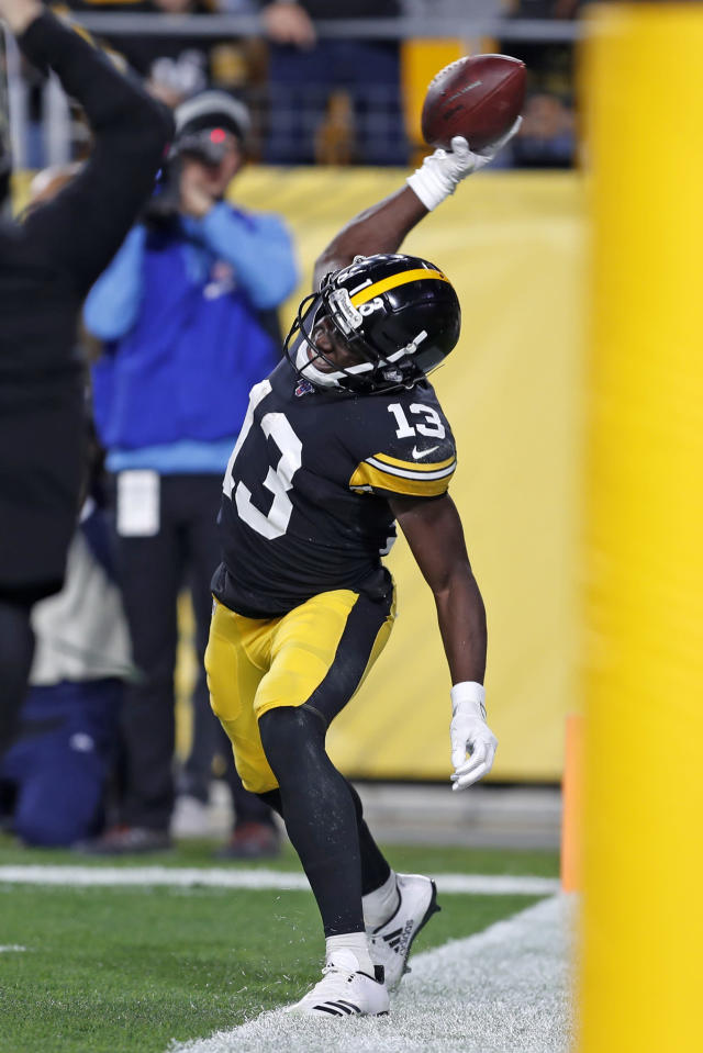Pittsburgh Steelers wide receiver James Washington (13) celebrates his touchdown catch from quarterback Mason Rudolph during the first half of an NFL football game against the Los Angeles Rams in Pittsburgh, Sunday, Nov. 10, 2019. (AP Photo/Keith Srakocic)
