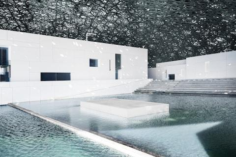 A quiet courtyard of reflecting pools is found at the entrance to the gallery