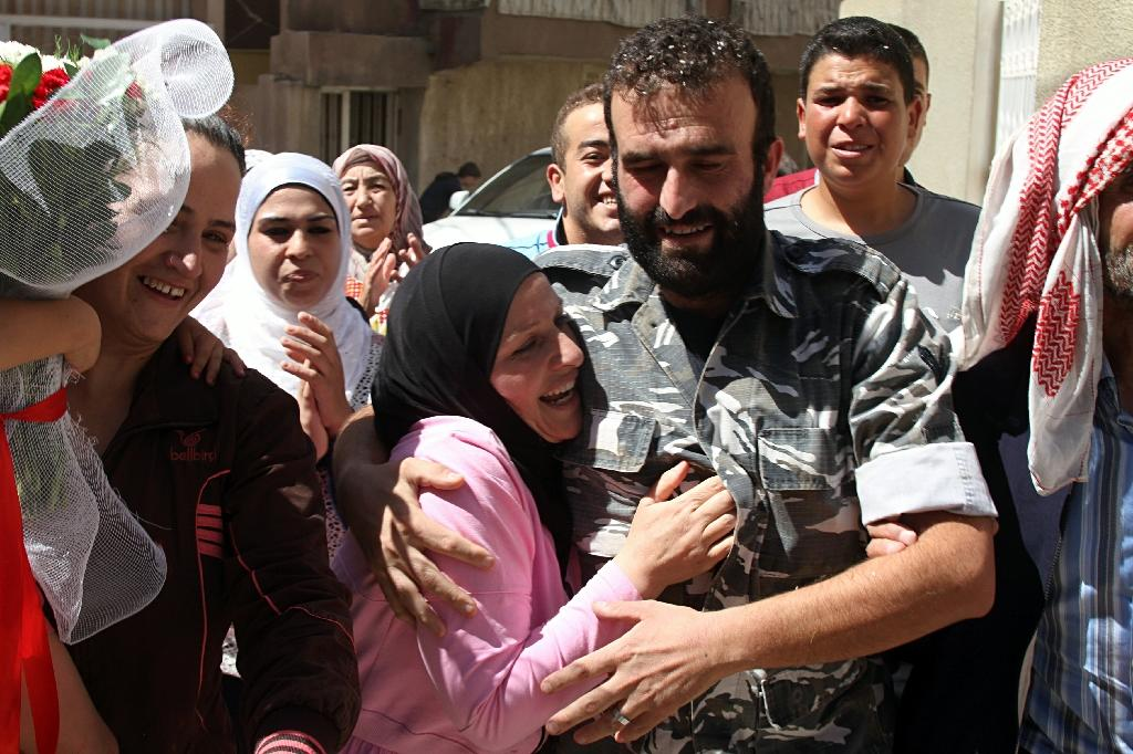 Lebanese police officer Saleh al-Baradei, kidnapped in Arsal by Syria's then Al-Qaeda affiliate Al-Nusra Front, celebrates his release on August 31, 2014 (AFP Photo/-)