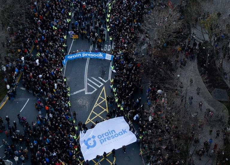 """Protesters hold a banner reading """"Now the Bask prisoners"""" during a protest in the northern Spanish city of Bilbao to demand the transfer of ETA prisoners to jails near their homes (AFP Photo/ANDER GILLENEA)"""