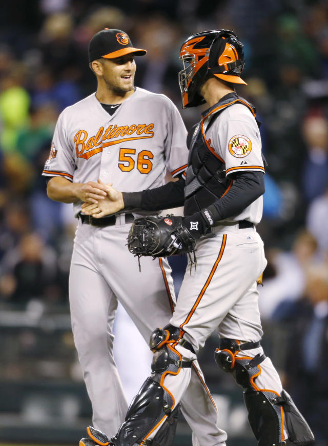 Baltimore Orioles closing pitcher Darren O'Day and catcher Caleb Joseph shake hands after the 4-0 win over the Seattle Mariners of a baseball game on Thursday, July 24, 2014 in Seattle. (AP Photo/John Froschauer)