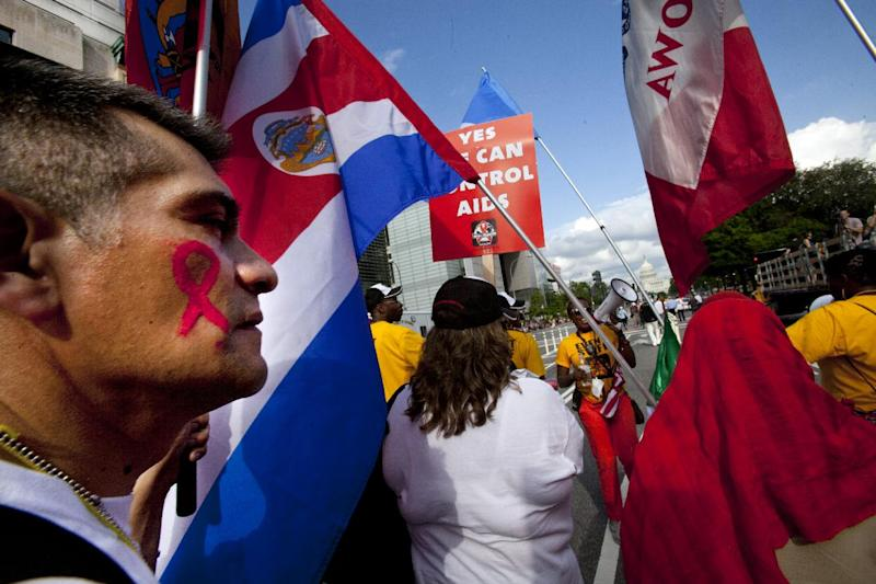 People walk toward the U.S. Capitol as part of the AIDS March in Washington, on Sunday, July 22, 2012. (AP Photo/Jacquelyn Martin)