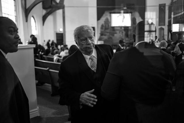 <p>Spencer Leak Sr exits a funeral, his sixth of the day, at Union Tabernacle Missionary Baptist Church on Chicago's south side. (Photo: Jon Lowenstein/NOOR for Yahoo News) </p>