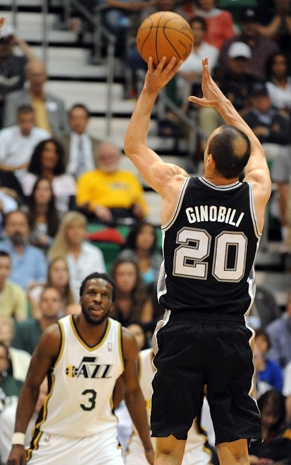 SALT LAKE CITY, UT  - MAY 7: Manu Ginobili #20 of the San Antonio Spurs hits a three point shot as DeMarre Carroll #3 of the Utah Jazz looks on  during the fourth quarter of Game Four of the Western Conference Quarterfinals in the 2012 NBA Playoffs at EnergySolutions Arena on May 07, 2012 in Salt Lake City, Utah. The Spurs won the game 87-81 and swept the Jazz four games to zero. NOTE TO USER: User expressly acknowledges and agrees that, by downloading and or using this photograph, User is consenting to the terms and conditions of the Getty Images License Agreement. (Photo by Steve Dykes/Getty Images)
