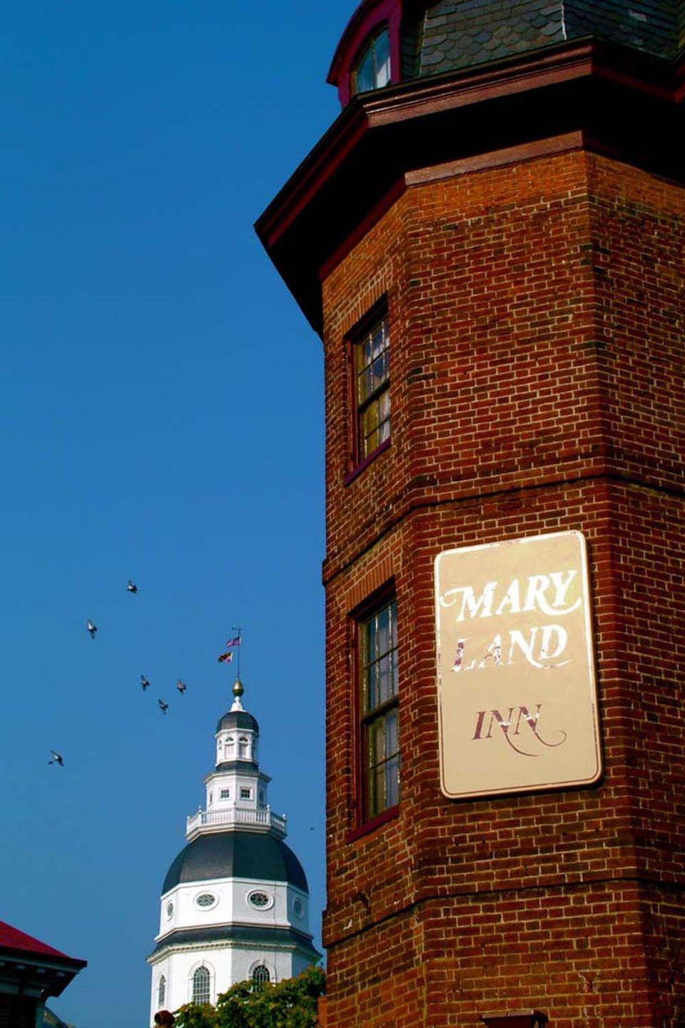 "<p>Located right on Main Street in charming <span class=""redactor-unlink"">downtown Annapolis</span>, this red-brick inn has been a central meeting place for national, state, and military visitors throughout its history. Its restaurant, the Treaty of Paris, honors the agreement that ended America's Revolutionary War in 1784.<br></p><p><strong>EXPLORE NOW: </strong><a href=""https://www.tripadvisor.com/Hotel_Review-s1-g29494-d89317-Reviews-Historic_Inns_of_Annapolis-Annapolis_Maryland.html"" rel=""nofollow noopener"" target=""_blank"" data-ylk=""slk:The Maryland Inn"" class=""link rapid-noclick-resp"">The Maryland Inn</a></p><p><em>Image via <a href=""https://www.flickr.com/photos/katmere/44195863/in/photolist-8uBttw-6vteJa-5VAWeX-3y7Vfh-nFsi3c-adi4E-adi3n-adibw-8X7zuP-adid2-e4fYVi-adi9N-4UvTD-9xdvht-5VAWdn-5VFgUL-6ccohL-6FX9XU-6FX9eS-5dbYV7-adi89-5d7Dt8-6FXa5h-6FX9jU-6FX9hG-5d7DcD-5d7E1k-6FX9iS-5dbYRL-5d7Dx2-5d7D2P-5dbZ3Q-5dbXD1-5dbZ7C-5dbYFW-5d7DAa-5d7Dha-HZdLFy-HZf5Dp-5dbY6W/"" rel=""nofollow noopener"" target=""_blank"" data-ylk=""slk:KATE MEREAND-SINHA"" class=""link rapid-noclick-resp"">KATE MEREAND-SINHA</a>/Flickr</em></p>"