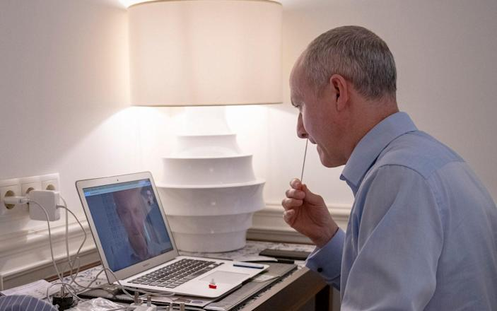 The Telegraph's Gordon Rayner completes a Covid test via video link before travelling back to London from Lisbon - Geoff Pugh/The Telegraph