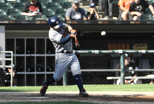 Houston Astros' Jose Altuve (27) hits a home run against the Chicago White Sox during the third inning of game one of a baseball doubleheader, Tuesday, Aug. 13, 2019, in Chicago. (AP Photo/David Banks)