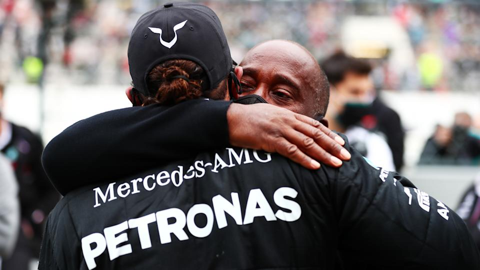 <em>Lewis Hamilton celebrates his record-breaking 92nd victory with his father, Anthony, after the F1 Grand Prix of Portugal at Autodromo Internacional do Algarve (Dan Istitene – Formula 1/Formula 1 via Getty Images).</em>