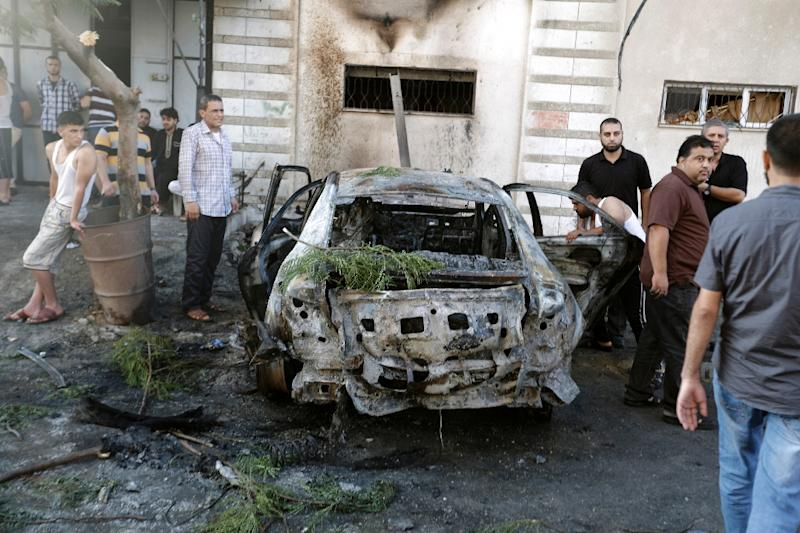 Witnesses in Gaza on July 19, 2015 said the explosions went off around 6:30 am and appeared to have been caused by bombs placed underneath the cars parked in front of their owners' homes (AFP Photo/Mohammed Abed)