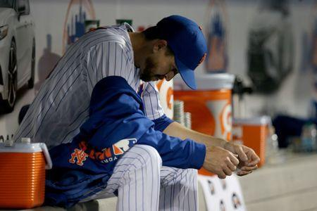 FILE PHOTO - Apr 9, 2019; New York City, NY, USA; New York Mets starting pitcher Jacob deGrom (48) reacts in the dugout during the fourth inning against the Minnesota Twins at Citi Field. Mandatory Credit: Brad Penner-USA TODAY Sports