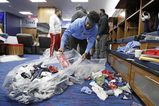 Tennessee Titans cornerback Malcolm Butler fills a bag with items as players clean out their lockers Monday, Jan. 20, 2020, in Nashville, Tenn. The Titans lost the AFC Championship NFL football game Sunday to the Kansas City Chiefs. (AP Photo/Mark Humphrey)