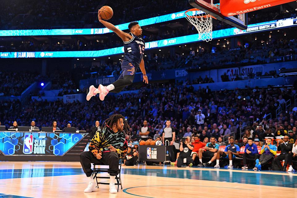 9Feb 16, 2019; Charlotte, NC, USA; New York Knicks forward Dennis Smith Jr dunks over Recording artist J Cole in the Slam Dunk Contest during the NBA All-Star Saturday Night at Spectrum Center. Mandatory Credit: Bob Donnan-USA TODAY Sports TPX IMAGES OF THE DAY