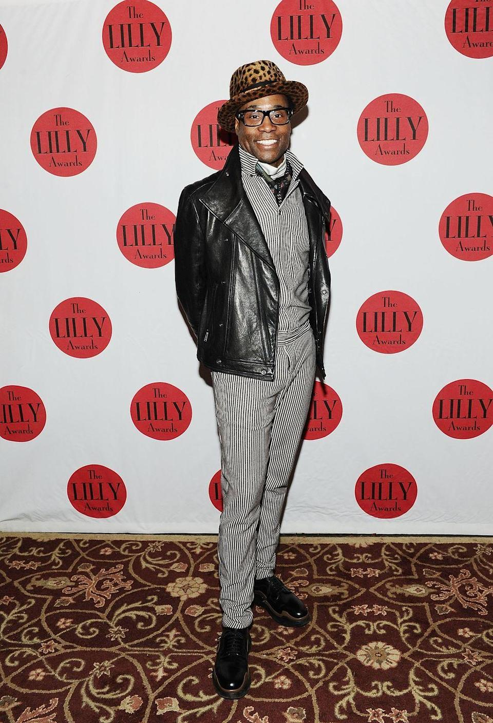 <p>Porter at the Lilly Awards Broadway Cabaret in a striped top, matching pants, a printed ascot, a leather motorcycle jacket, and a leopard-print hat.</p>