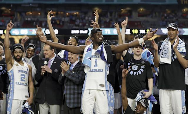 <p>North Carolina's Theo Pinson (1) and the rest of the team celebrate after the finals of the Final Four NCAA college basketball tournament against Gonzaga, Monday, April 3, 2017, in Glendale, Ariz. North Carolina won 71-65. (AP Photo/David J. Phillip) </p>