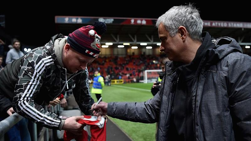 Mourinho signing autographs for fans. Pic: Getty