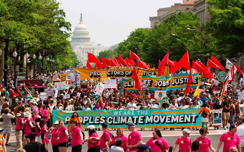 Demonstrators march on Pennsylvania Avenue during the People's Climate March in Washington DC - AFP
