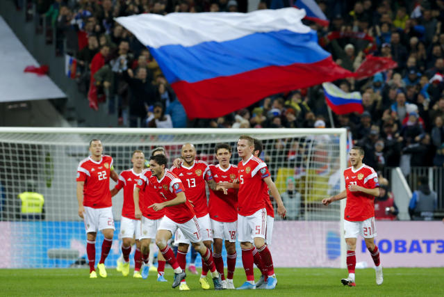 Russia's Magomed Ozdoev, foreground center, celebrates after scoring his side's second goal during the Euro 2020 group I qualifying soccer match between Russia and Scotland at the Luzhniki Stadium in Moscow, Russia, Thursday, Oct. 10, 2019. (AP Photo/Alexander Zemlianichenko)