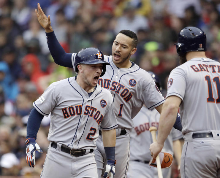 Houston Astros third baseman Alex Bregman (2) celebrates his home run with Carlos Correa, rear, and Evan Gattis, right during the eighth inning of Game 4 in baseball's American League Division Series against the Boston Red Sox, Monday, Oct. 9, 2017, in Boston. (AP Photo/Charles Krupa)