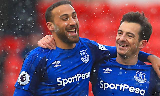 Everton's Cenk Tosun and Leighton Baines celebrate after the final whistle.