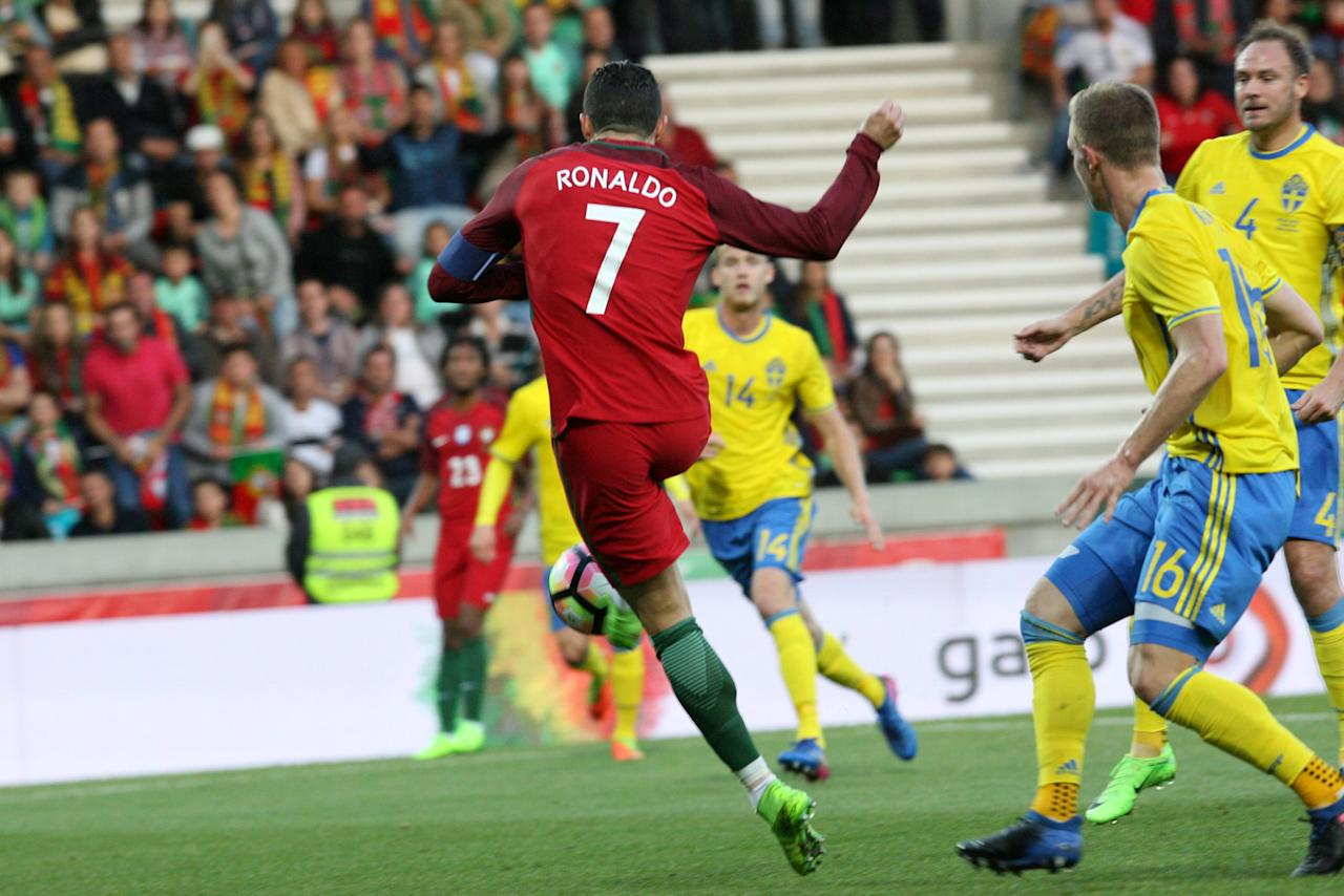 Football Soccer - Portugal v Sweden - International Friendly - Barreiros stadium, Funchal, Portugal - 28/03/17. Portugal's Cristiano Ronaldo scores his goal against Sweden.  REUTERS/Duarte Sa