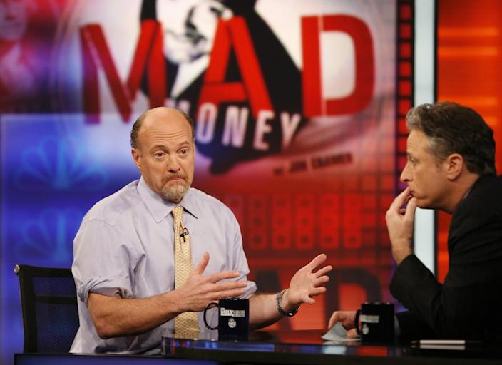 """Jim Cramer, left, host of the """"Mad Money"""" show on CNBC, talks with Jon Stewart during an appearance"""