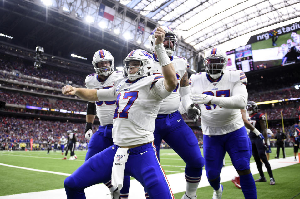 Buffalo Bills quarterback Josh Allen (17) celebrates after catching a pass for a touchdown against the Houston Texans in the playoffs. (AP Photo/Eric Christian Smith)