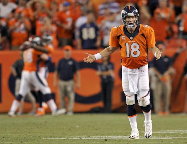 Denver Broncos quarterback Peyton Manning (18) celebrates his seventh touchdown of the game against the Baltimore Ravens during the second half of an NFL football game, Thursday, Sept. 5, 2013, in Denver. (AP Photo/Jack Dempsey)