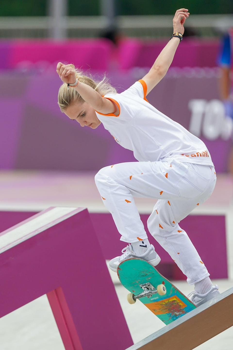 <p>Roos Zwetsloot of the Netherlands stood out in bright orange, rocking these incredibly cool bird covered slacks during the Women's Street Final.</p>