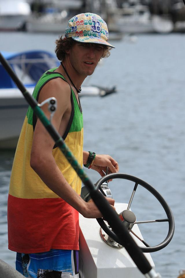 Gloucester, MA - A shot of Pinwheel Owner/Captain Tyler McLaughlin working on his boat.