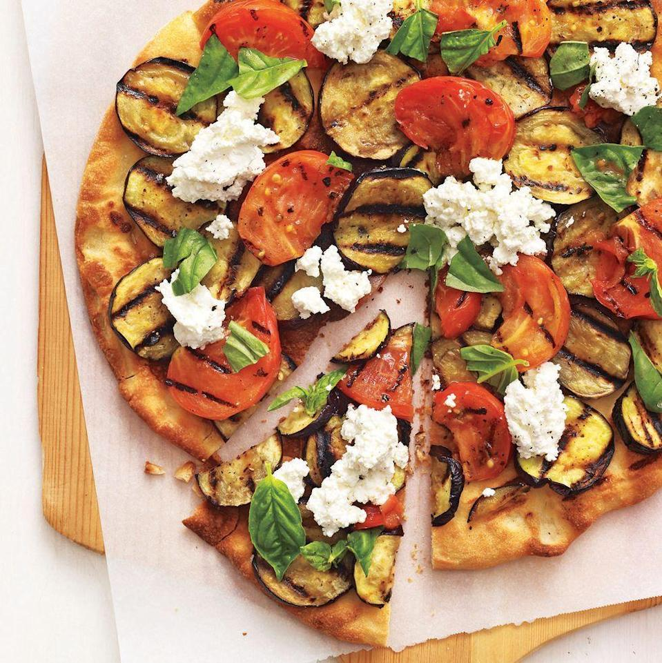 "<p>Indulge your pizza craving with this delicious and healthy pizza that spotlights grilled eggplant and tomatoes. </p><p><strong><em><a href=""https://www.womansday.com/food-recipes/food-drinks/recipes/a11722/grilled-eggplant-parmesan-pizza-recipe-122958/"" rel=""nofollow noopener"" target=""_blank"" data-ylk=""slk:Get the Grilled Eggplant Parmesan Pizza recipe."" class=""link rapid-noclick-resp"">Get the Grilled Eggplant Parmesan Pizza recipe. </a></em></strong></p>"