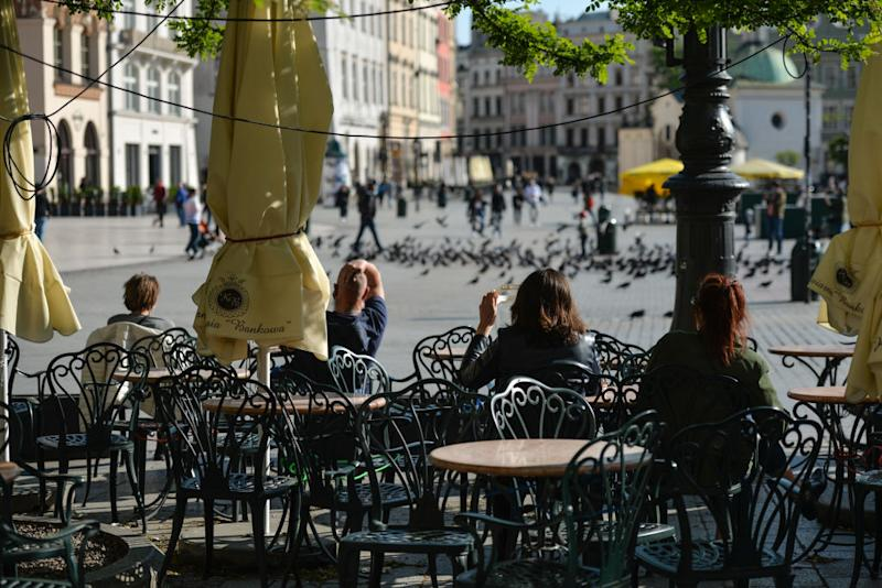 Restaurants and cafes prepare their outdoor seating for Monday's re-opening in Krakow's Main Market Square. From Monday, May 18th, the third stage of unfreezing the economy and loosening restrictions will takes place , including the opening of beauty salons, restaurants, bars and cafes. On Saturday, May 16, 2020, in Krakow, Poland. (Photo by Artur Widak/NurPhoto)
