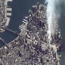 "A satellite image of lower Manhattan shows smoke and ash rising from the site of the World Trade Center at 11:43 AM on September 12, 2001. The fires at Ground Zero continued to burn for 99 days after the attack -- a bleak reminder, day and night, of the thousands who lost their lives, and the countless millions more who lived, but whose lives were forever transformed. <br><br>(Photo: Getty Images)<br><br>For the full photo collection, go to <a href=""http://www.life.com/gallery/59971/911-the-25-most-powerful-photos#index/0"" rel=""nofollow noopener"" target=""_blank"" data-ylk=""slk:LIFE.com"" class=""link rapid-noclick-resp"">LIFE.com</a>"