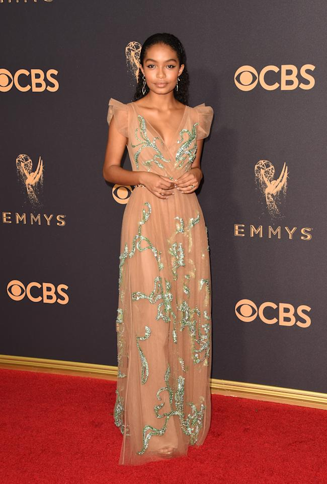 <p>The 17-year-old actress attended the show with her <em>Black-ish</em> co-stars while filming her own spin-off, <em>Grown-ish</em>. The title of the upcoming sitcom is certainly fitting, with Shahidi looking gorgeous grown up in a nude-pink chiffon gown. (Photo: Getty Images) </p>