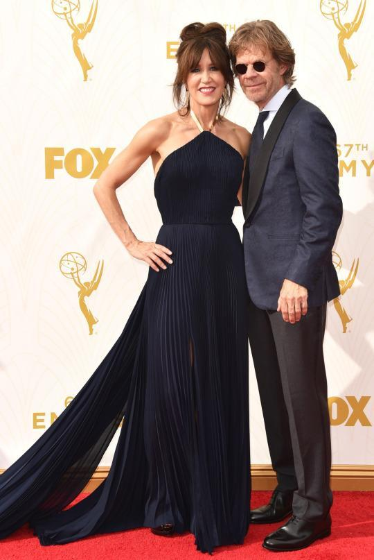 <p>Felicity Huffman, who recently dyed her blonde hair to a much darker brunette shade, wore a navy blue pleated dress with a halter top. The dress, while great, would've been fantastic had it not been for her distracting beehive hairstyle. </p>
