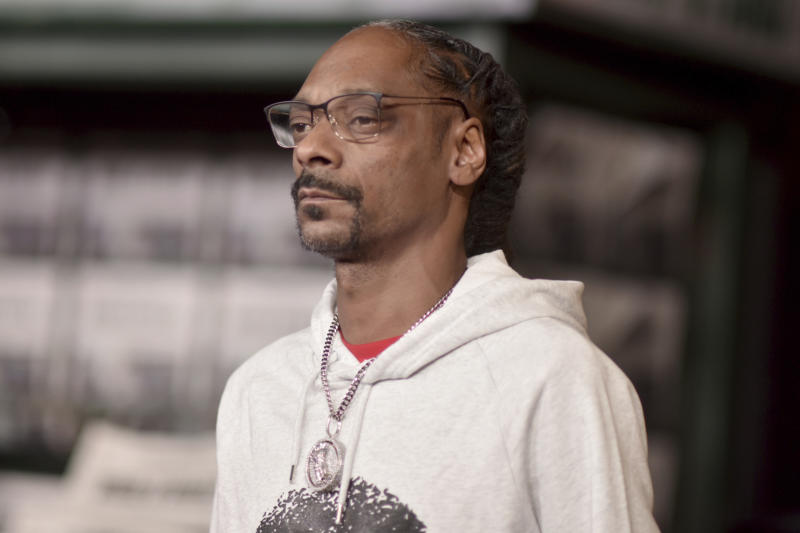 """FILE - In this Thursday, Oct. 24, 2019 file photo, Snoop Dogg arrives at the Los Angeles premiere of """"The Irishman,"""" at the TCL Chinese Theatre. On Saturday, Feb. 8, 2020, the CBS News chief called threats against journalist Gayle King """"reprehensible"""" as backlash grew against rapper Snoop Dogg and others critical of King for an interview where she asked about a sexual assault charge against the late Kobe Bryant. (Photo by Richard Shotwell/Invision/AP)"""