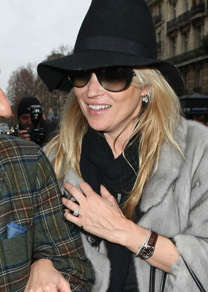 """English supermodel Kate Moss showed off her blingin' new engagement ring on her way to visit the Chanel store in Paris on Friday. British newspaper <i>The Sun</i> first reported the news Thursday, revealing that Kate's fiance, The Kills rocker Jamie Hince, reportedly popped the question Tuesday night, and that the couple is planning to wed on July 2, 2011. <a href=""""http://www.pacificcoastnews.com/"""" target=""""new"""">PacificCoastNews.com</a> - February 4, 2011"""