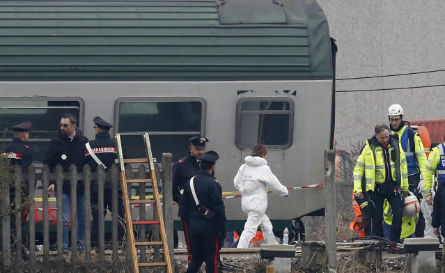 <p>Scientific police officer and rescuers stand by the wagons of a derailed train in Pioltello Limito, on the outskirts of Milan, Italy, Thursday, Jan. 25, 2018. (Photo: Antonio Calanni/AP) </p>