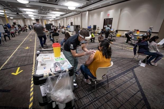 Peel Public Health closed two of their mass vaccination sites this week to divert resources to targeted strategies that bring the shot to communities with lower vaccine uptake, such as mobile clinics and outreach initiatives. (Evan Mitsui/CBC - image credit)