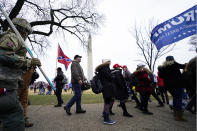 FILE - In this Jan. 6, 2021, file photo, Trump supporters gather on the Washington Monument grounds in advance of a rally in Washington. Both within and outside the walls of the Capitol, banners and symbols of white supremacy and anti-government extremism were displayed as an insurrectionist mob swarmed the U.S. Capitol. (AP Photo/Julio Cortez, File)