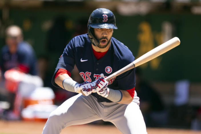 Boston Red Sox's Marwin Gonzalez (12) reacts to being called out on strikes during the second inning of a baseball game against the Oakland Athletics, Sunday, July 4, 2021, in Oakland, Calif. (AP Photo/D. Ross Cameron)