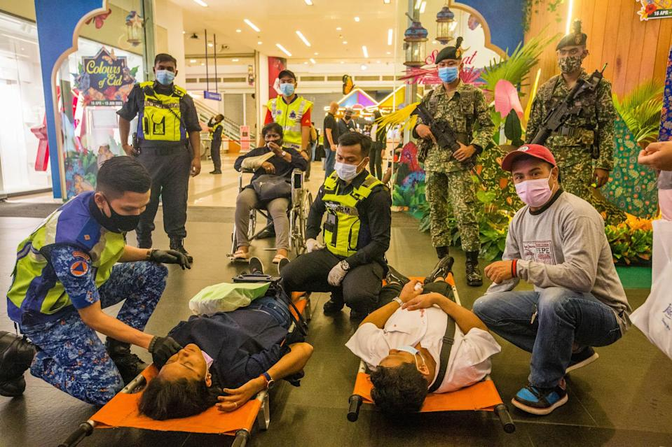 Rescue personnel tending to the injured passengers at KLCC station, after a collision between two LRT trains on the Kelana Jaya line, May 24, 2021. — Picture by Firdaus Latif