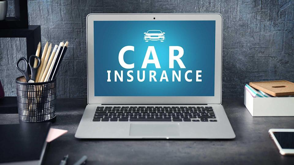 Laptop on table showing car insurance